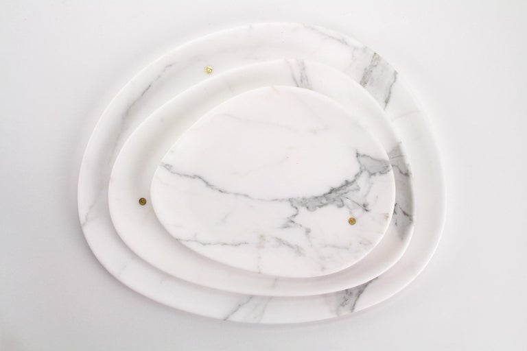 Hand carved presentation plates in Statuary marble. Multiple use as plates, platters and placers. Dimensions: Small - L 24 W 20 H 1.8 cm, Medium - L 30 W 28 H 1.8 cm and Big - L 36 W 35 H 1.8 cm.