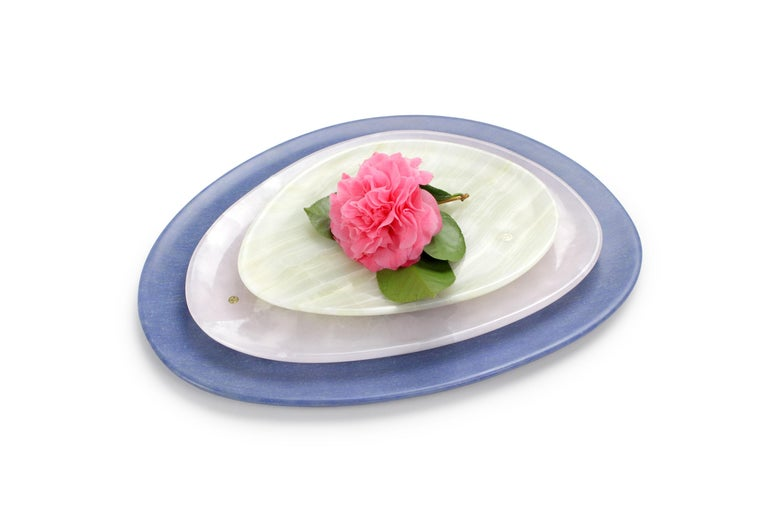 Hand carved presentation plates in green onyx, pink onyx and Azul Macaubas. Multiple use as plates, platters and placers. Dimensions: Small L 24, W 20, H 1.8 cm, medium L 30, W 28, H 1.8 cm, big L 36, W 35, H 1.8 cm.  Pieruga proudly creates elegant