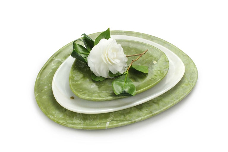 Hand carved presentation plates in Green Ming marble and white onyx. Multiple use as plates, platters and placers. Dimensions: Small - L 24 W 20 H 1.8 cm, Medium - L 30 W 28 H 1.8 cm, Big - L 36 W 35 H 1.8 cm.  Pieruga proudly creates elegant