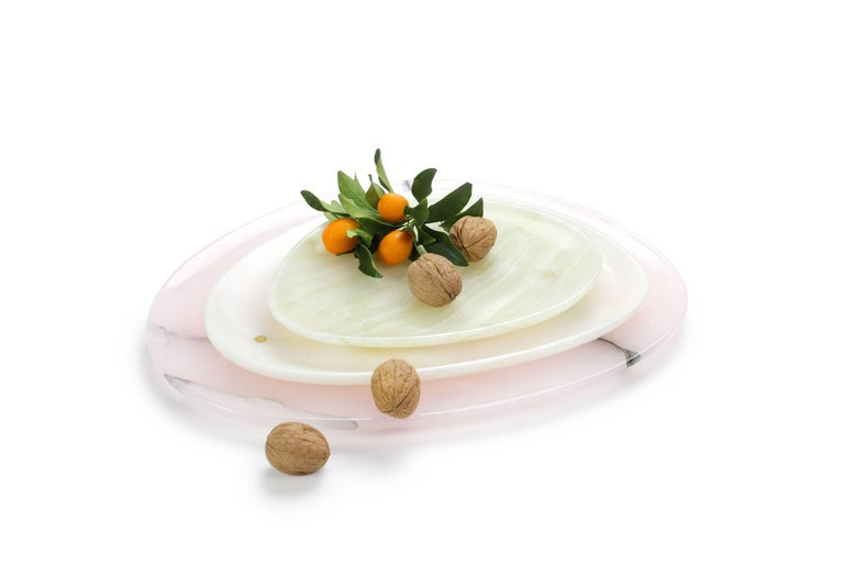 Hand carved presentation plates in green, white and pink onyx. Multiple use as plates, platters and placers. Dimensions: Small - L24 W20 H1.8 cm, Medium - L30 W28 H1.8 cm, Big - L36 W35 H1.8 cm.  Pieruga proudly creates elegant accessories and