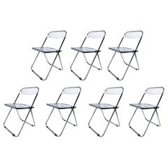 "Set of Seven Castelli ""Plia"" Lucite Folding Chairs"