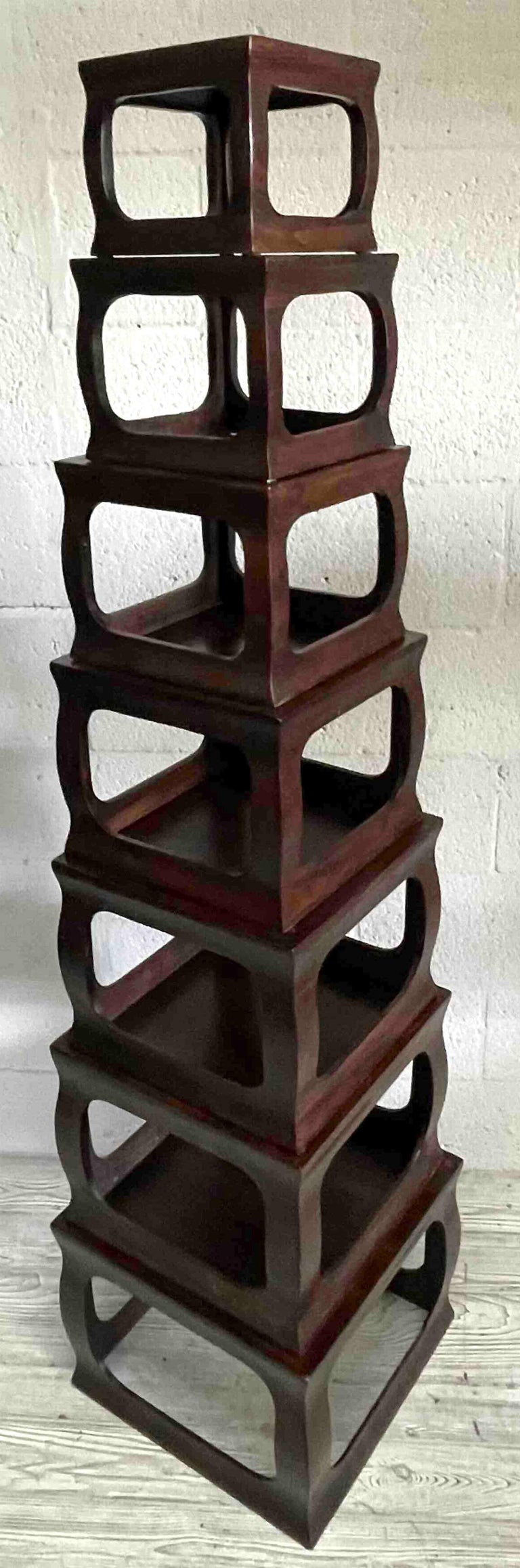 Set of seven Chinese export stacking Campaignstyle pedestals consisting of seven carved wood square stands as shown the height is 64.5