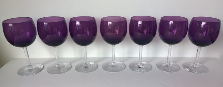 Offered is a set of seven crystal wine or water goblets / glasses in a beautiful deep purple shade and clear stem by Fostoria. This set of barware/ crystal goblets in deep purple and clear gleaming crystal would be perfect for holiday entertaining