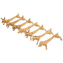 Set of Seven French Modernist Gilded Animal Knife Rests