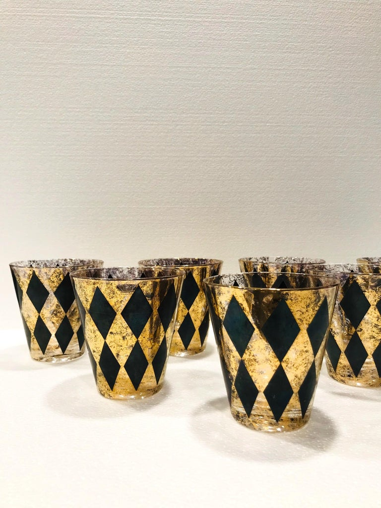 American Set of Seven Hollywood Regency Barware Rock Glasses in Gold and Black, 1960s For Sale