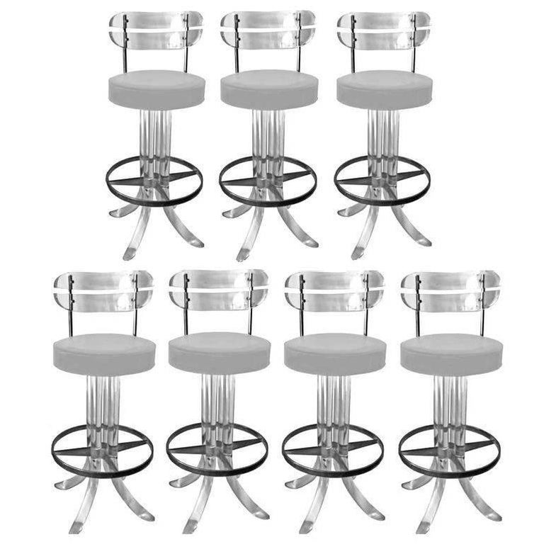 Set of Seven Lucite Bar Stools For Sale