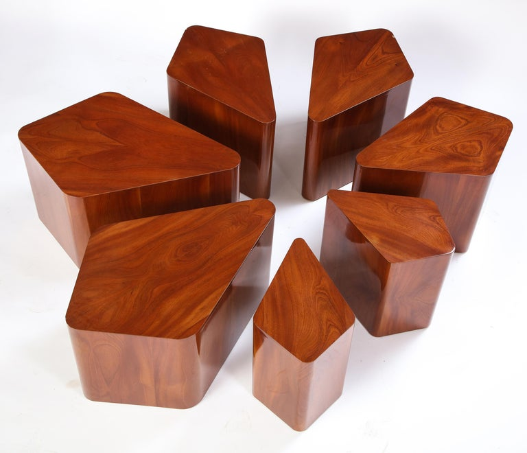 This set is composed of seven petal-shaped side tables of varying sizes made from lacquered maple. Designed by interior designer Juan Montoya, these lacquered wood tables can be arranged together to form a larger flower-shaped table or dispersed