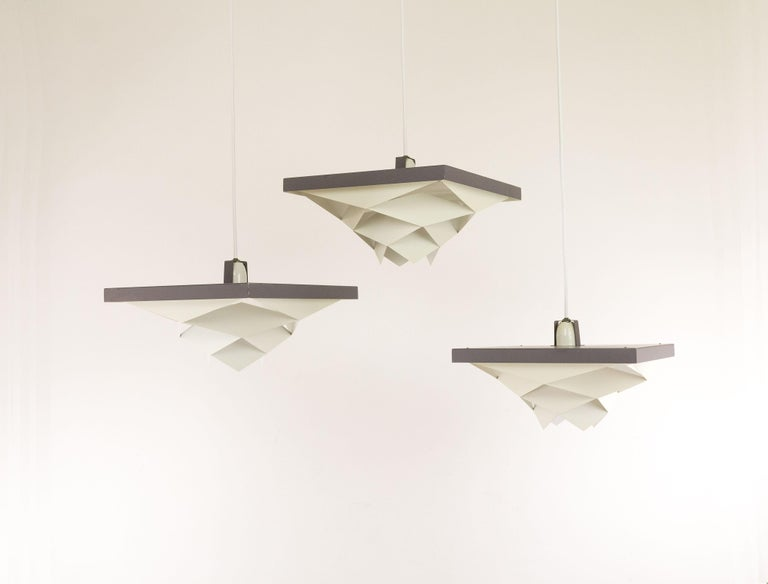 Set of seven Danish midcentury Symfoni pendants, designed by Preben Dahl in the early 1960s and produced by Hans Følsgaard Belysning.  Originally the lamps were part of a series of similarceiling lights and pendantsthat were made of white and