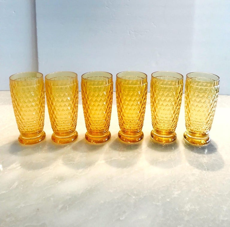 Set of seven luxury crystal highball barware glasses from Villeroy & Boch's Boston series. The glasses are comprised of hobnail crystal with Classic diamond patterns and smooth rounded bases. In gorgeous amber colored crystal, making them a unique