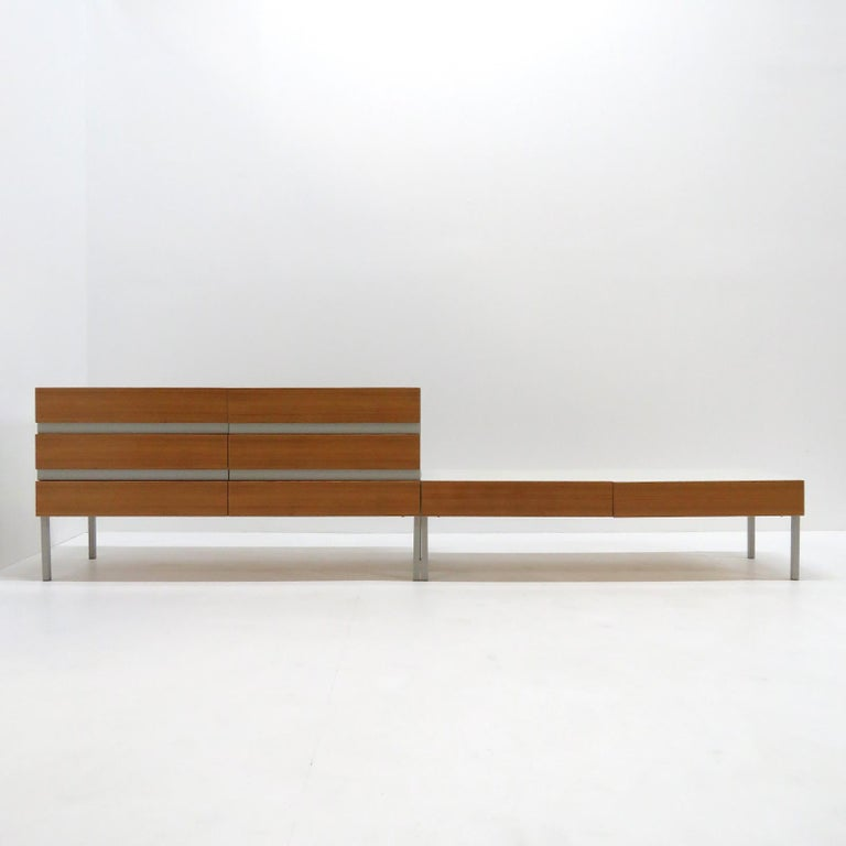 Wonderful set of two low sideboards by Interlübke, Germany, 1970 with 8 wooden drawer fronts and white corpus on grey steel legs.