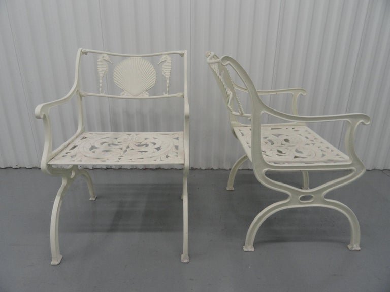 Set of 6 armchairs designed by Molla in the 1950s. They are made of cast aluminum and are painted in an off-white finish. Sturdy and heavy.