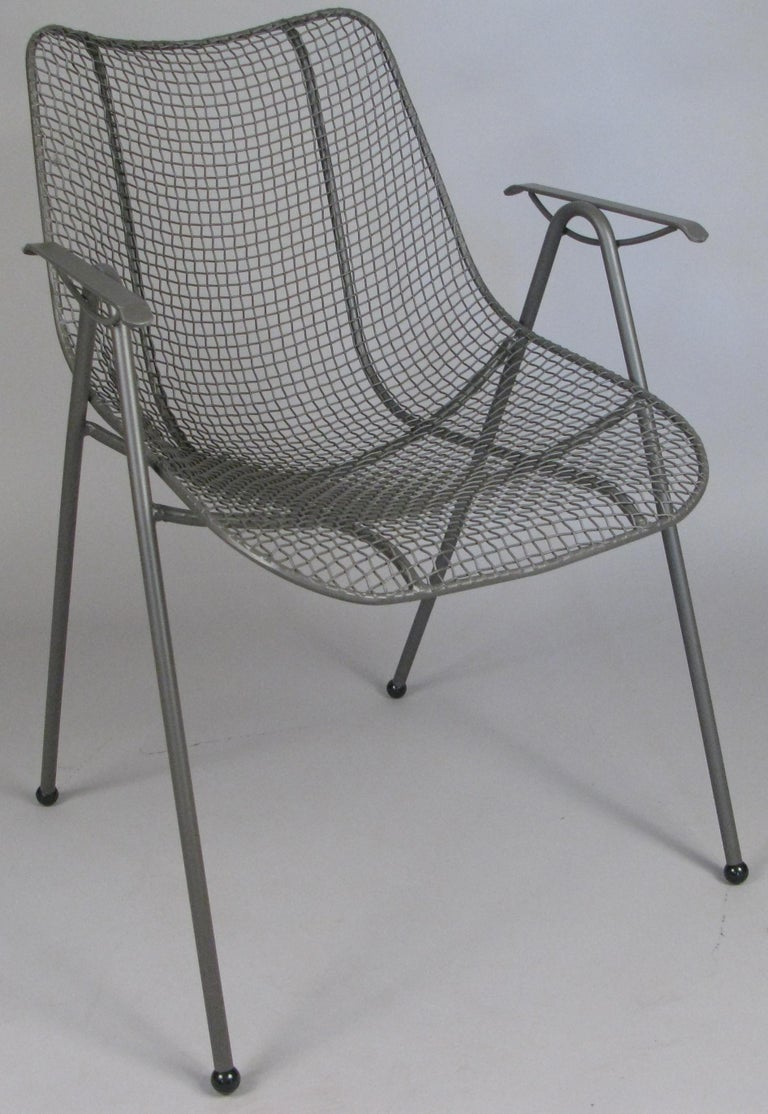 A matched set of six 1950s wrought iron dining chairs from Russell Woodard's Sculptura collection. With Woodard's signature woven steel mesh seats, all chairs refinished in greige.