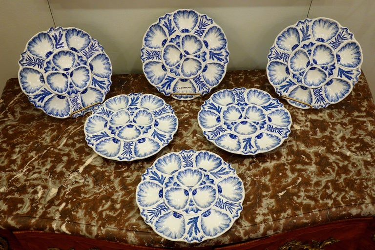 Set of six highly-decorative blue and white French faience oyster plates stamped