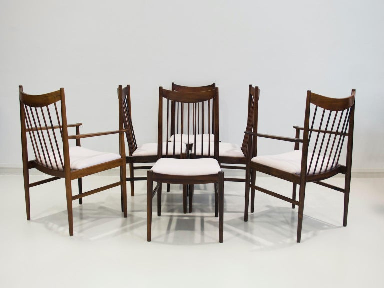 Set of six chairs, model 422, designed by Arne Vodder in the 1960s. Four chairs without arms and two with arms. Frame in solid hardwood, seats reupholstered in very light pink furniture fabric, 63% CO and 37% LI. Produced by Sibast Furniture.