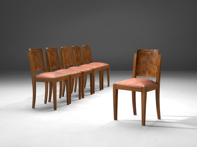 Set of 6 dining chairs, leather and walnut, Italy, 1930s  This set of six Art Deco dining chairs is upholstered in soft pink leather. The frame is made of solid walnut and features a sturdy, masculine design. The legs are rectangular and straight.