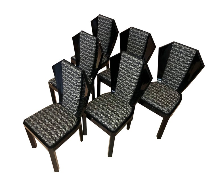 Wonderful and rare set of six original Art Deco Dining Room Chairs. The set of chairs has a very eccentric, fan-shaped design with a big conical backrest. The wood frame is blackened and shellac hand-polished with a high-gloss surface.  The back and