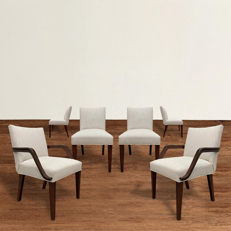 A striking set of six American Art Deco dining chairs by Gilbert Rohde for Herman Miller, c. 1937, fully restored and upholstered with new Perennials indoor/outdoor performance fabric. The set includes two armchairs and four side chairs.