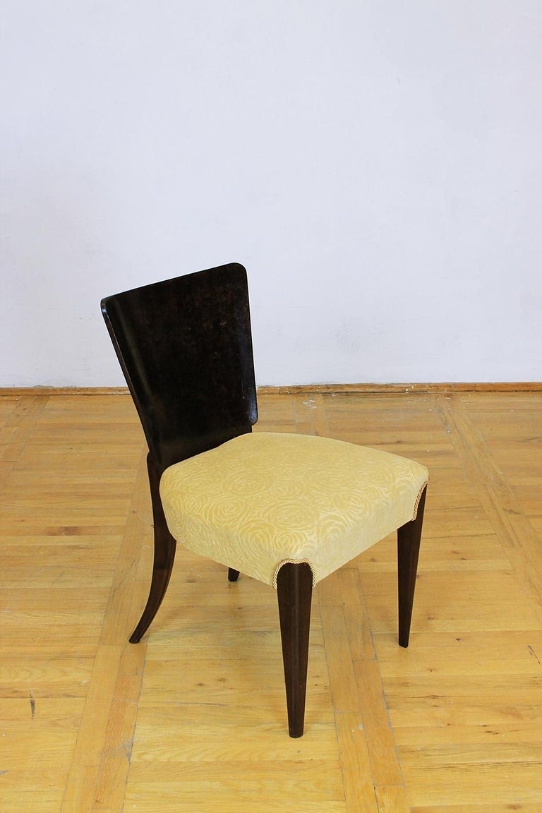 These Art Deco chairs, model H - 214, were designed by Jindrich Halabala and manufactured by Up Zavody in Czechoslovakia. The set features a walnut veneer with newly upholstered seats. The wood has been refreshed and the shape has been kept in every