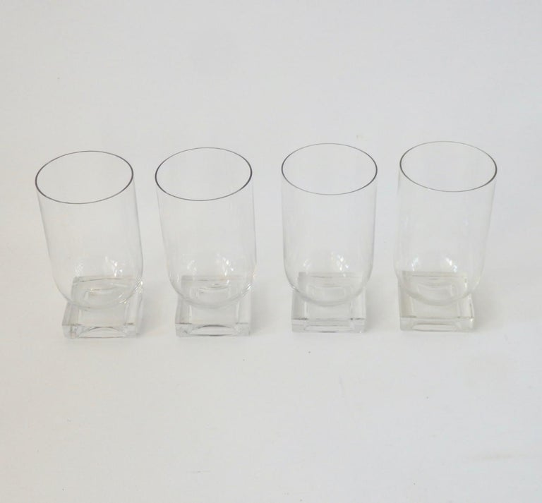 Art Deco design water glasses. Square base supports round tumblers.