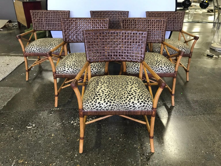 Hickory White luxurious matching set of six bamboo dining chairs with woven leather backs and cheetah print upholstered seats. In immaculate condition, looks brand new, never used.