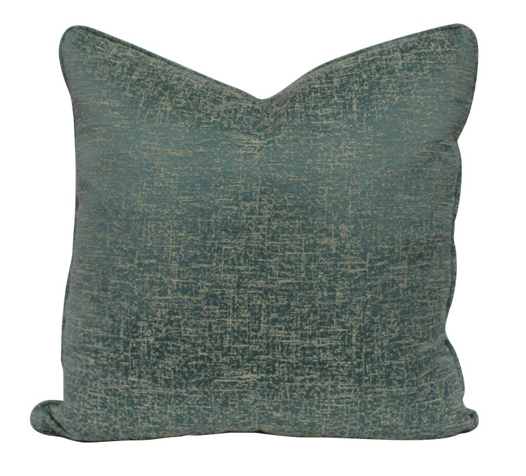 A set of six textured silk in duck egg blue cushions, with feather pads.