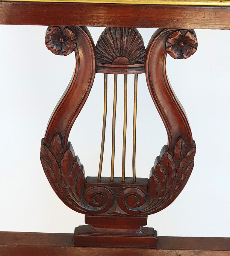Set of six Biedermeier lyre chairs, Northern Germany, 1820s. Made of mahogany. Very good, original condition.  Conical square legs on the front, square legs on the back. Straight chair frame. Upholstery and upholstery are original. The upholstery