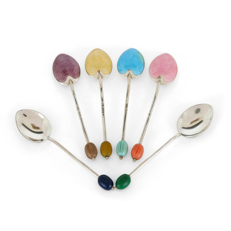 Set of six Birmingham coloured enamel and silver spoons English, 1933 Spoon: Length 10cm, width 3cm Case: Height 2cm, width 16cm, depth 13cm  This beautiful set of spoons is by the English silversmiths Turner and Simpson. The silver spoons