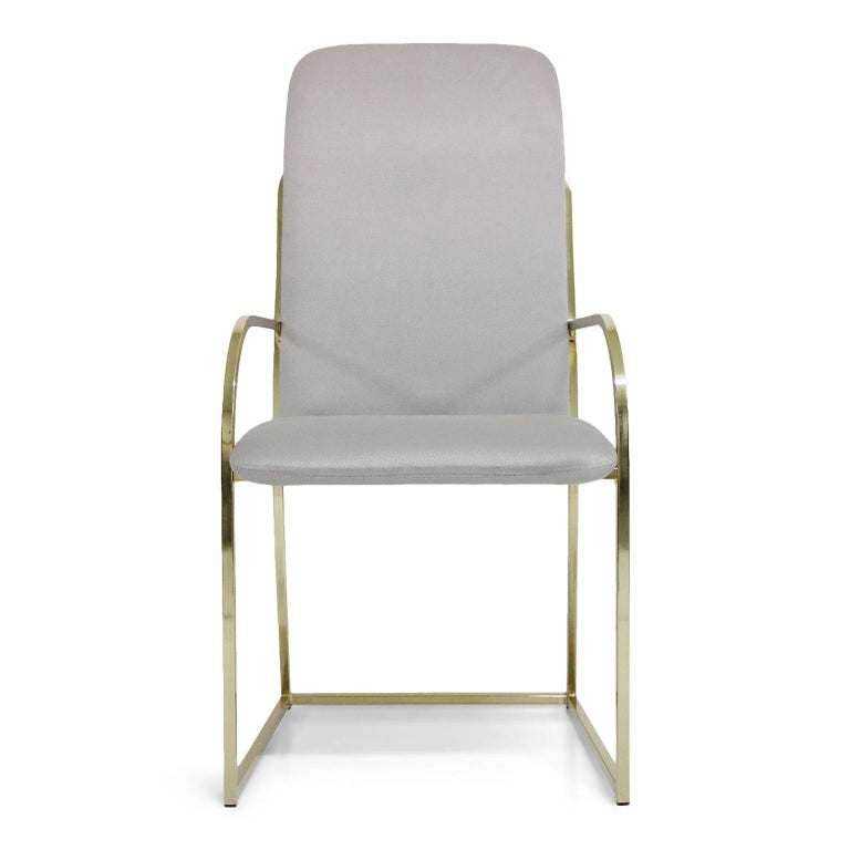 This set of six (6) brass dining chairs are by Design Institute America and labelled underneath each chair. Two (2) captains armchairs and four (4) side chairs. Nice bright and clean brass with sculptural lines make this set an excellent candidate