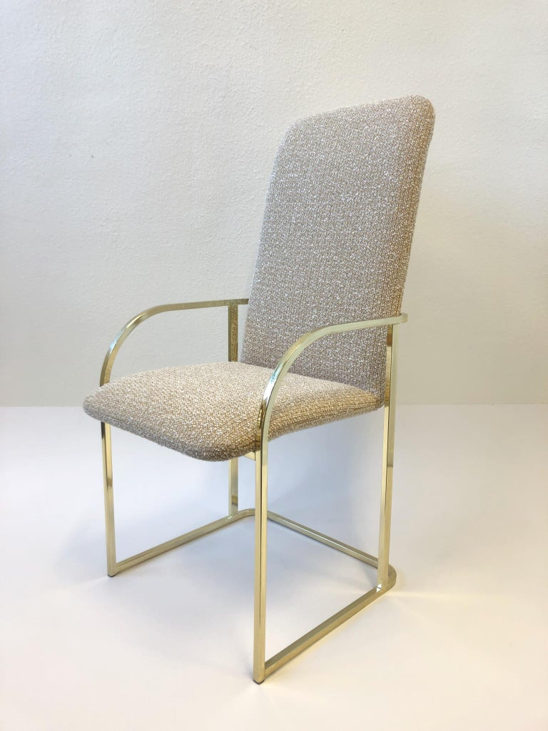 A glamorous set of six polish brass high back dining chairs designed by Design Institute of America. Newly recovered in a beautiful nubby fabric (see detail photos). The brass shows minor wear. 