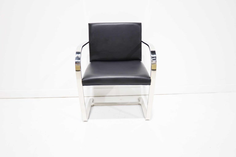 The Brno chairs was designed by Ludwig Mies van der Rohe for Knoll. It is an iconic design that works well in many environments. This set has a polished stainless steel frame and is upholstered in a faux leather. Chairs are very clean and