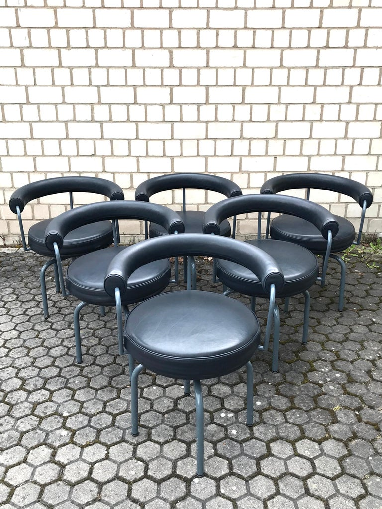 Italian Set of Six Cassina Swivel Arm Chairs LC7 by Le Corbusier, Perriand & Jeanneret For Sale