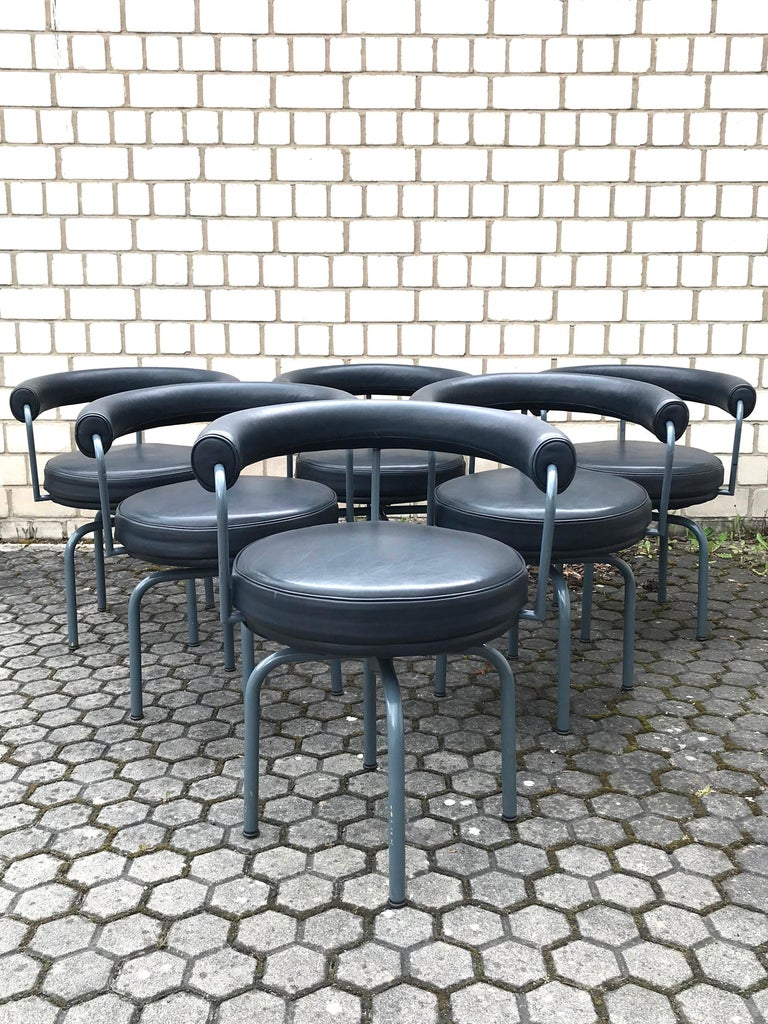 Enameled Set of Six Cassina Swivel Arm Chairs LC7 by Le Corbusier, Perriand & Jeanneret For Sale