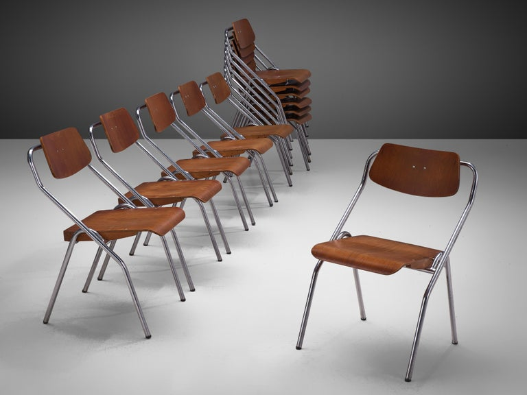 Set of 6 dining chairs, metal and plywood, the Netherlands, circa 1930s  This very large set of mid-century, Dutch School chairs would be a great choice for your project if you are looking for folding chairs that are easy to store. The seats are