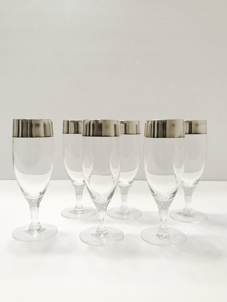 Set of six elegant Mid-Century Modern stemware glasses designed by Dorothy Thorpe. The rare champagne glasses feature short stems with the iconic sterling silver rims for which Thorpe is recognized and highly sought after. These make an excellent