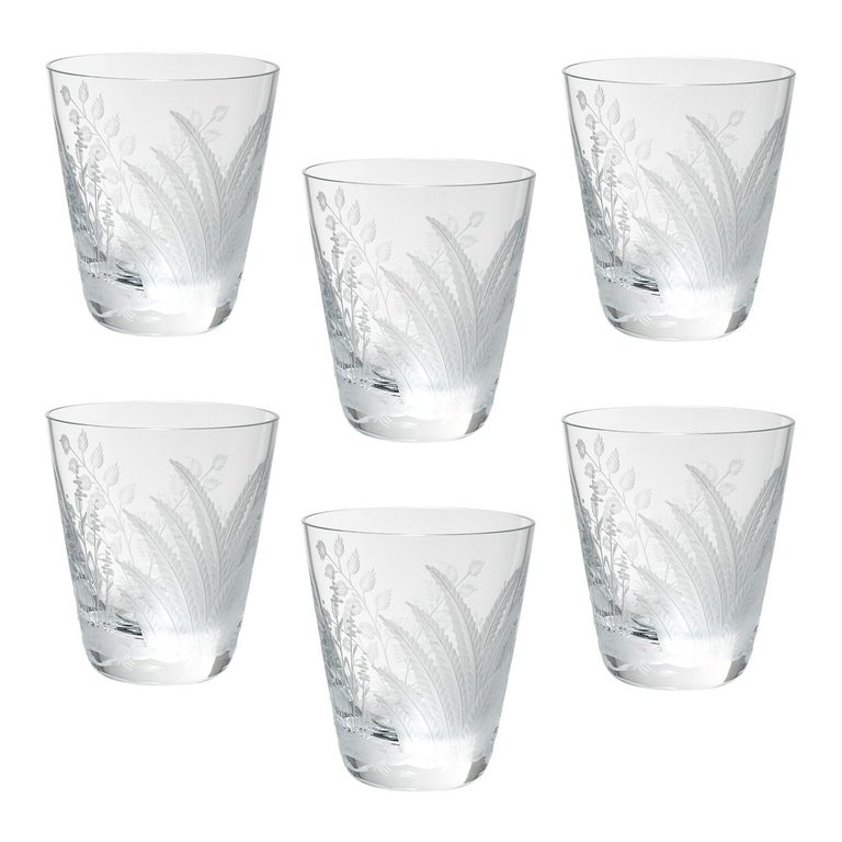 Set of six hand blown tumbler in clear crystal with a hand-edged country style fern decor. The decor shows a hand-engraved decor with fern leaves all-over the glass. Handmade in Bavaria/Germany. Can be ordered also in amber or green. A matching