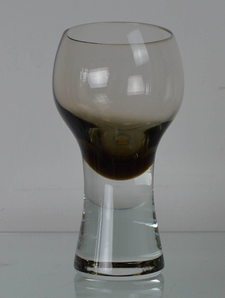 Very chic set of tinted drinking glasses.  Wonderful asymmetrical shape. Highly evocative of the 1970s.  Great color. Seems to change in different lights.  Free shipping.