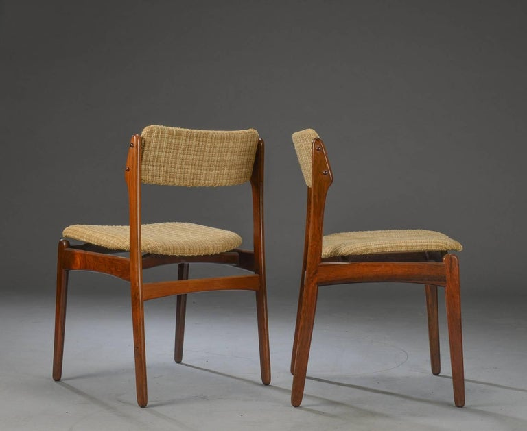 Set of six Danish dining chairs in rosewood veneer from the late 1970s, by Erik Buck model 49. Padded seat and back.  Price