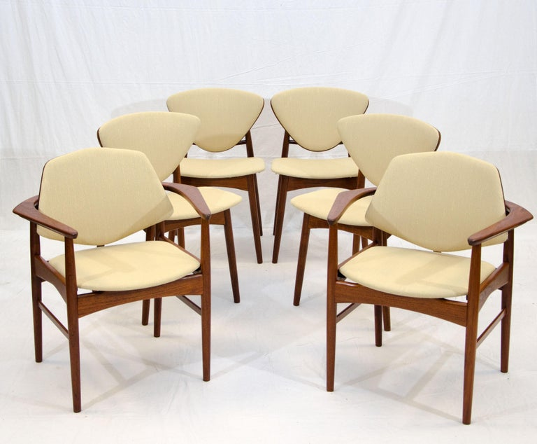 Unusual chairs with upholstered seats and back fronts, the rear of the chair backs are teak. There is a