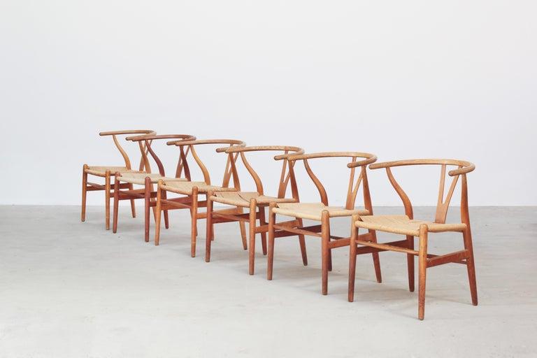 20th Century Set of Six Danish Wishbone Chairs CH 24 by Hans J. Wegner for Carl Hansen Oak For Sale