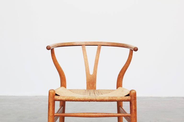 Set of Six Danish Wishbone Chairs CH 24 by Hans J. Wegner for Carl Hansen Oak For Sale 5