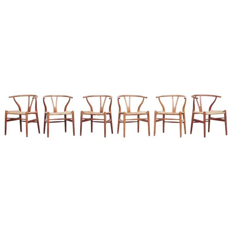 Set of Six Danish Wishbone Chairs CH 24 by Hans J. Wegner for Carl Hansen Oak For Sale