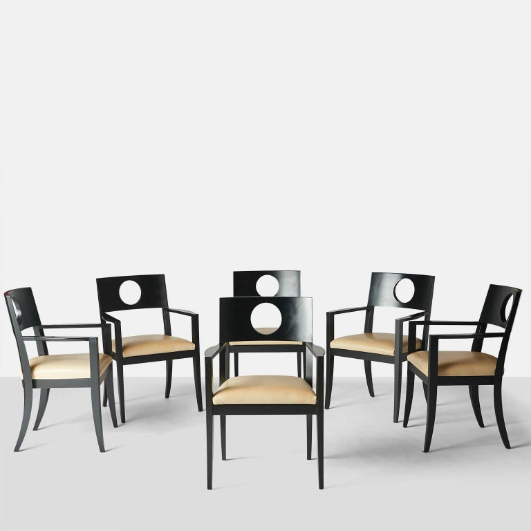 Set of six dining armchairs by Michael Graves. A very rare set of six armchairs designed by Michael Graves and manufactured by Atelier International. The frame is a matte black lacquer and seats have been upholstered in a faux leather, USA, circa