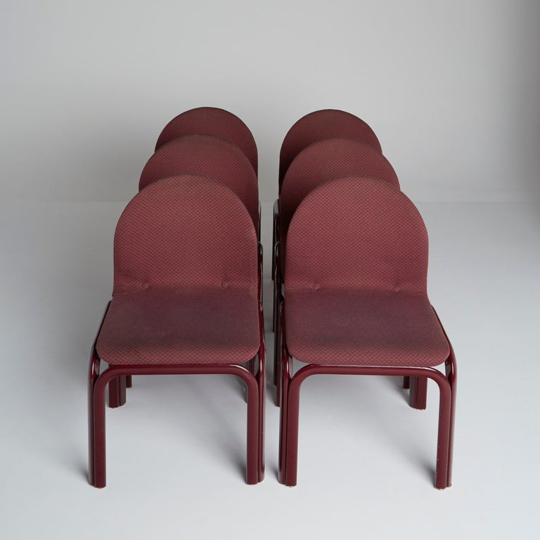 Set of Six (6) Model #54A chairs by Gae Aulenti for Knoll International with burgundy lacquered steel frames and sinuous bent plywood seats with its original fabric upholstery, original Knoll International labels/tags located underneath.  The frames