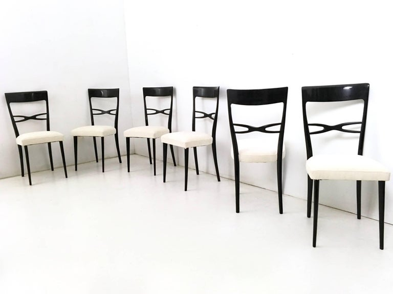 Made in ebonized wood and padding upholstered in light ivory fabric.  They have been reupholstered and relacquered, therefore they are in perfect condition.  Measures:  Width: 42 cm Depth: 48 cm  Height: 95 cm.