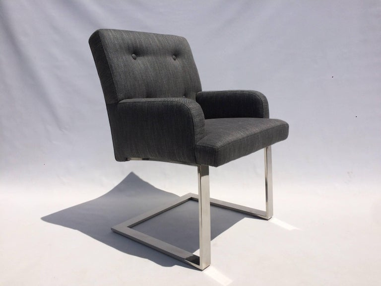 Set of six dining chairs, two armchairs and four side chairs from Paul Evans for Directional. Stainless steel and new charcoal-gray wool upholstery. Measures: Side chairs are 19