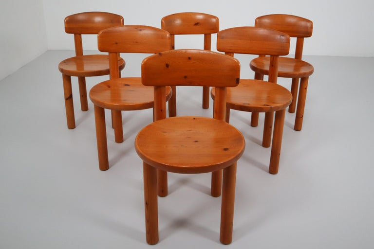 Amazing set of four dining chairs designed by Rainer Daumiller, manufactured by Hirtshals Sawmill in Denmark, circa 1970.  This impressive set contains four dining chairs, made in the highest quality solid pinewood in the natural rich brown /