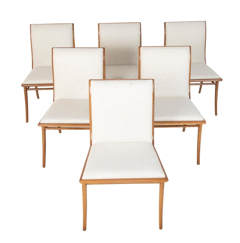 A wonderful set of six bleached mahogany dining chairs by T. H Robsjohn-Gibbings.