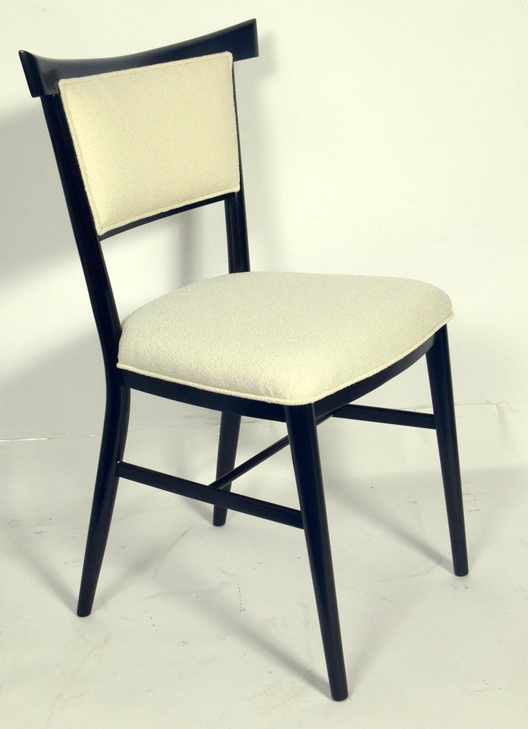 Set of six dining chairs, designed by Paul McCobb for Directional, circa 1950s. This set has been completely restored in an ultra-deep brown lacquer with ivory bouclé upholstery. The two armchairs measure 35.5