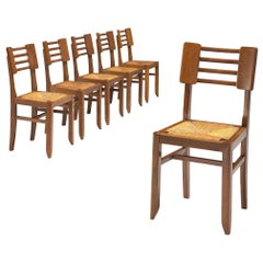 Set of Six Dining Chairs in Oak and Cane by Pierre Cruege