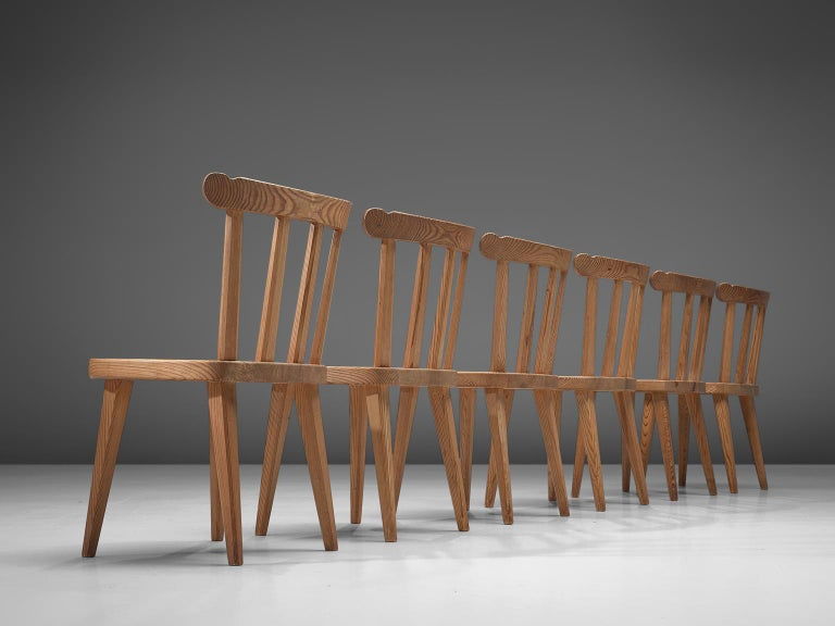 Nordiska Kompaniet, set of 6 dining chairs 'Ekerö, pine, Sweden 1930s.   Elegant set of six dining chairs. Executed in northern European pinewood. The design is simplistic; four tapered legs, solid seating and spindel or slat back. These chairs